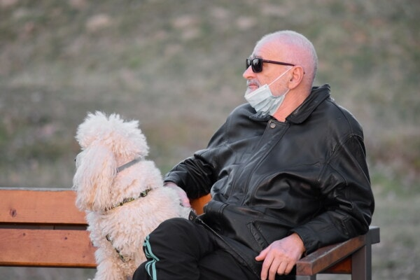 self isolation, social distance, pet, relaxing, elderly, man, dog, bench, face mask, outdoors