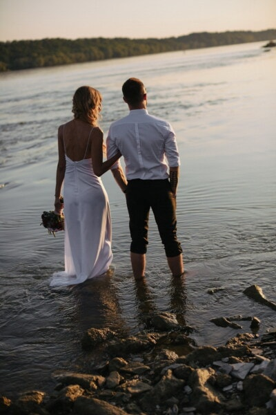 husband, handsome, newlyweds, gorgeous, young woman, riverbank, panorama, sunset, standing, water