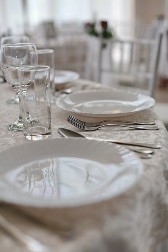 silverware, cutlery, spoon, fork, knife, table, tablecloth, dining area, lunchroom, glass