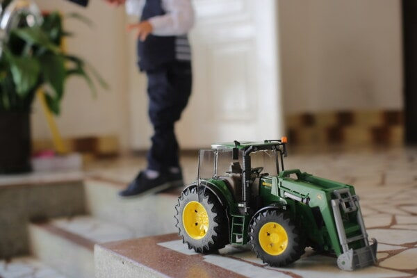 toy, vehicle, tractor, toddler, boy, indoors, machinery, blur, child, machine