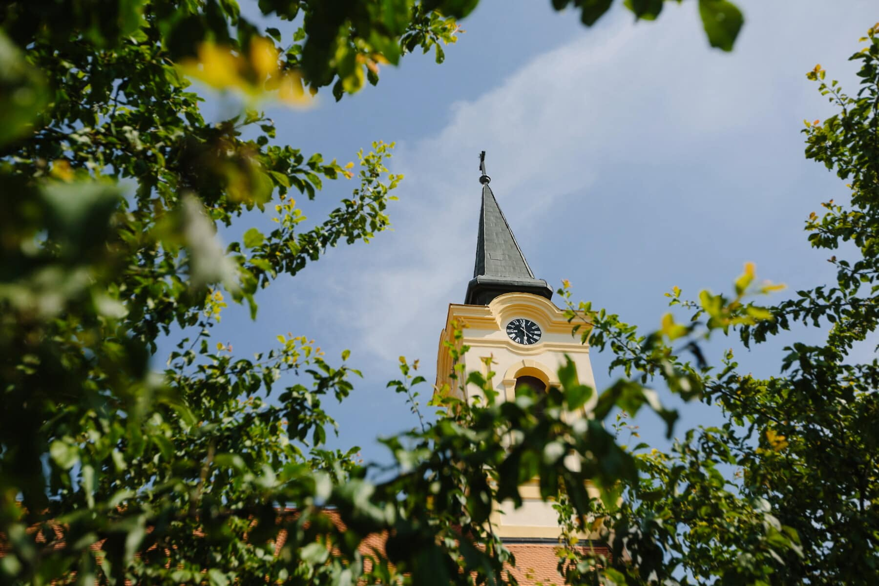 church, church tower, yellowish, facade, cross, distance, analog clock, cathedral, architecture, building