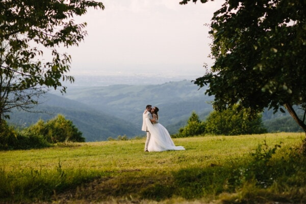 hugging, newlyweds, knoll, hillside, valley, hilltop, love, wedding, engagement, bride
