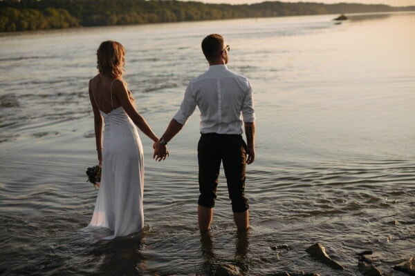 holding hands, just married, sunset, riverbank, water, barefoot, legs, girl, beach, love
