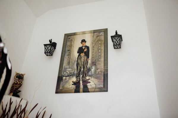 Charlie Chaplin painting, fine arts, walls, fancy, lantern, interior design, art, indoors, room, furniture