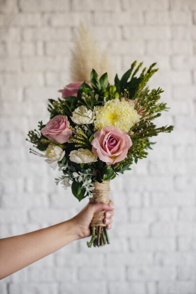 bouquet, arrangement, hand, white, bricks, wall, flowers, nature, decoration, leaf