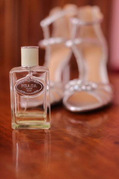 Prada perfume, bottle, shoes, sandal, liquid, glass, luxury, wood, elegant
