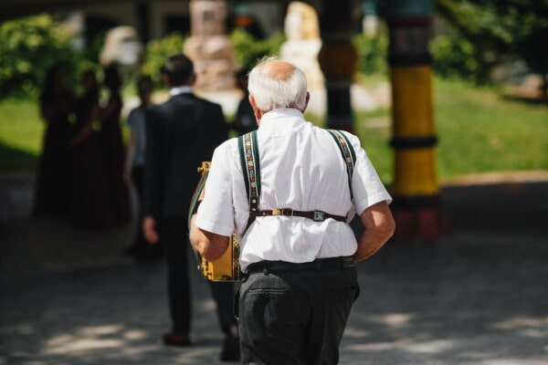 old man, elderly, walking, accordion, musician, street, person, people, city, man