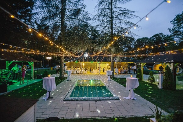 evening, nighttime, nightclub, backyard, fancy, event, hotel, resort area, swimming pool, restaurant