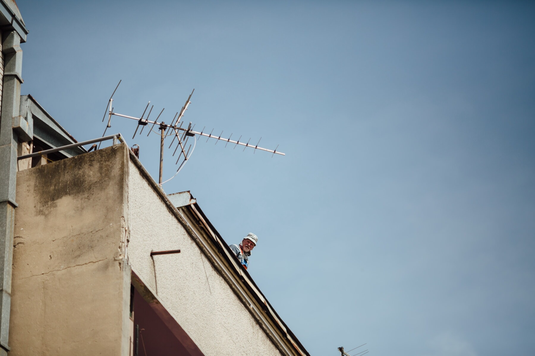 pensioner, roof, rooftop, old man, building, antenna, electricity, technology, industry, wind
