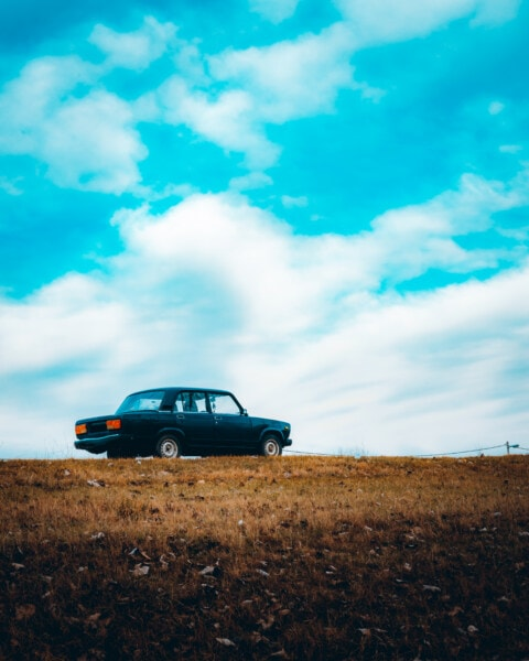 sedan, car, hilltop, blue sky, field, countryside, rural, meadow, vehicle, landscape