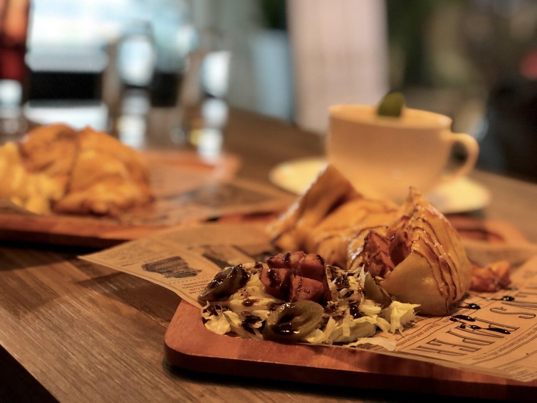 dinner, dinner table, restaurant, bread, salad, meat, newspaper, food, wood, indoors