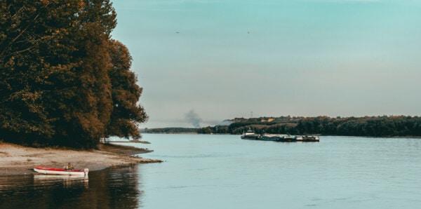 cargo ship, barge, fishing boat, river boat, river, riverbank, shore, water, lakeside, beach