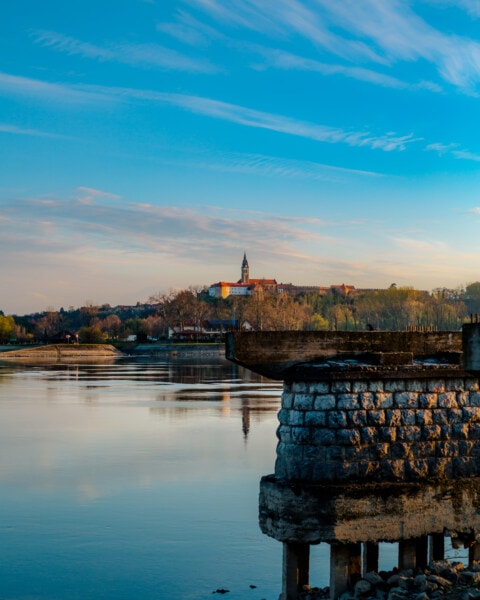 bridge, abandoned, stones, concrete, river, riverbank, church tower, castle, water, sunset