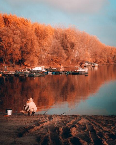 Angeln, Fischer, am See, Hafen, Herbstsaison, Landschaft, Orange gelb, goldener Schein, Natur, See
