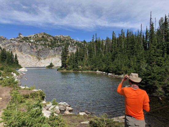 hiking, hiker, lakeside, hat, person, river, water, mountain, forest, landscape