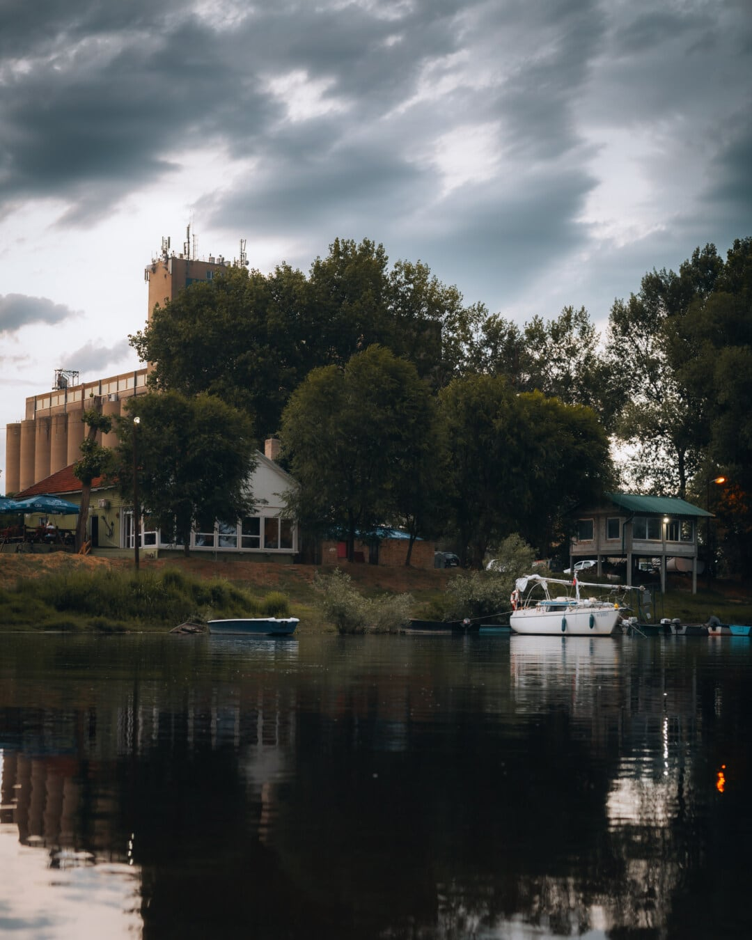 clouds, dark blue, urban area, lakeside, dock, resort area, home, river, water, reflection