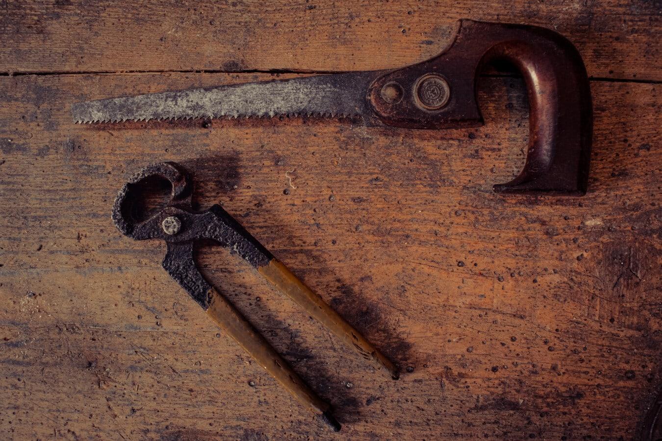 pliers, saw, tool, hand tool, vintage, workshop, repair shop, iron, wood, steel