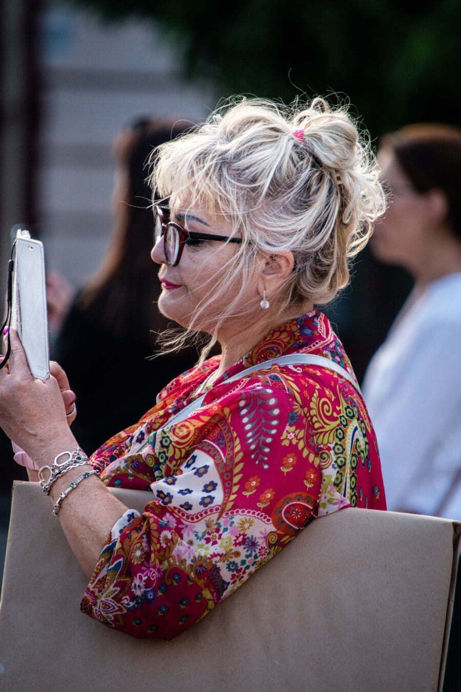 businesswoman, blonde hair, eyeglasses, mobile phone, holding, woman, festival, girl, portrait, street