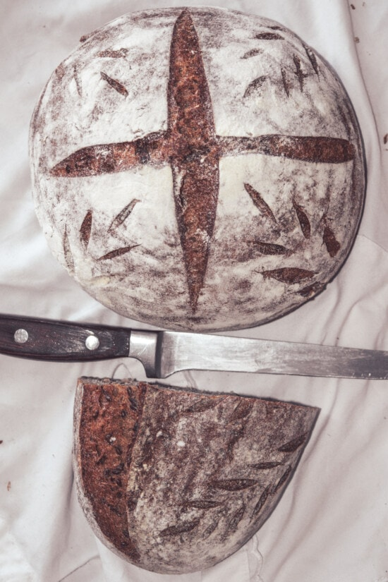 knife, kitchen table, wholemeal bread, bread, baked goods, lunch, cutter, food, tool, crust