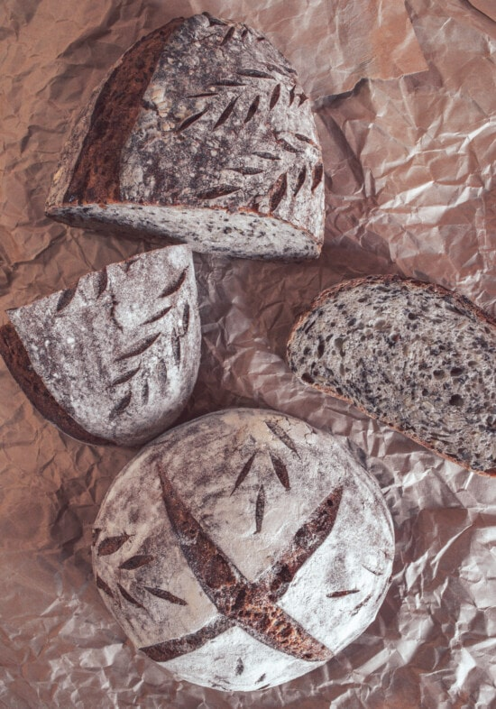 bread, wholemeal flour, wholemeal bread, half, slices, roast, crust, dark, paper, traditional