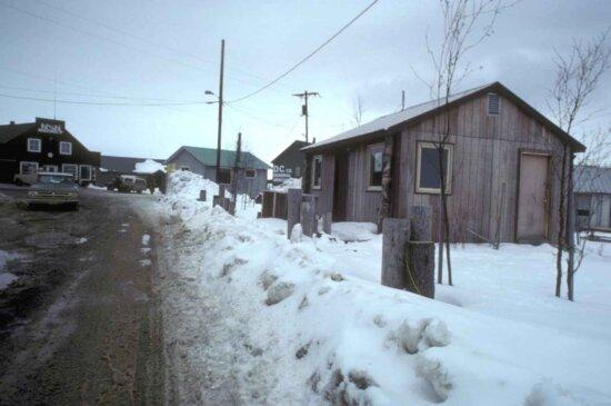 snowbound, wooden, houses, muddy, road