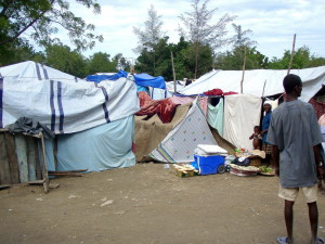 haitian, man, standing, outside, makeshift, tent, homes