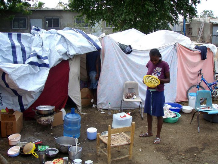 haitian, woman, standing, outside, makeshift, tent, home