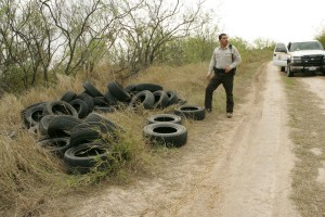 law, enforcement, officer, inspects, tires, illegally, dumped
