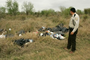 law, enforcement, officer, inspects, trash, illegally, dumped