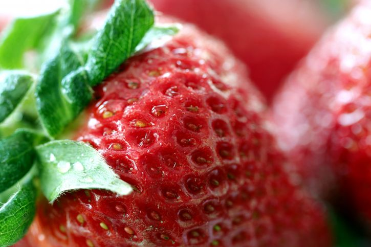red, ripe, strawberry, revealing, rough, dimpled, skin, fruit
