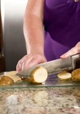 preparing, washed, white potatoes, glass cutting board