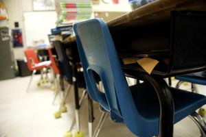row, plastic, seats, tucked, respective, desks