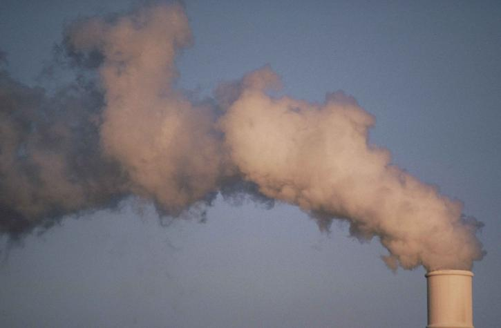 Air pollution smoke rising from plant tower