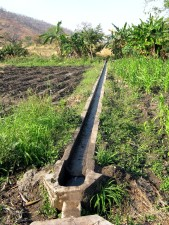 irrigiation, improves, farming, feeder, channel, diverts, water, mpmemba, stream