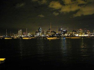 skyline, buildings, water, sailboats, nighttime
