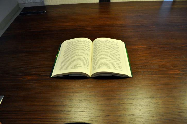 book, table, opened, half, jaundiced