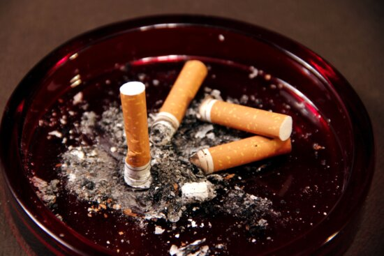 four, cigarette, butts, ashes
