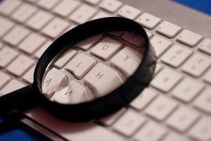 magnifying glass, computer, wireless keyboard