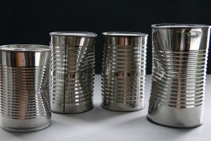 four, unlabeled, metal, cans, unknown, food