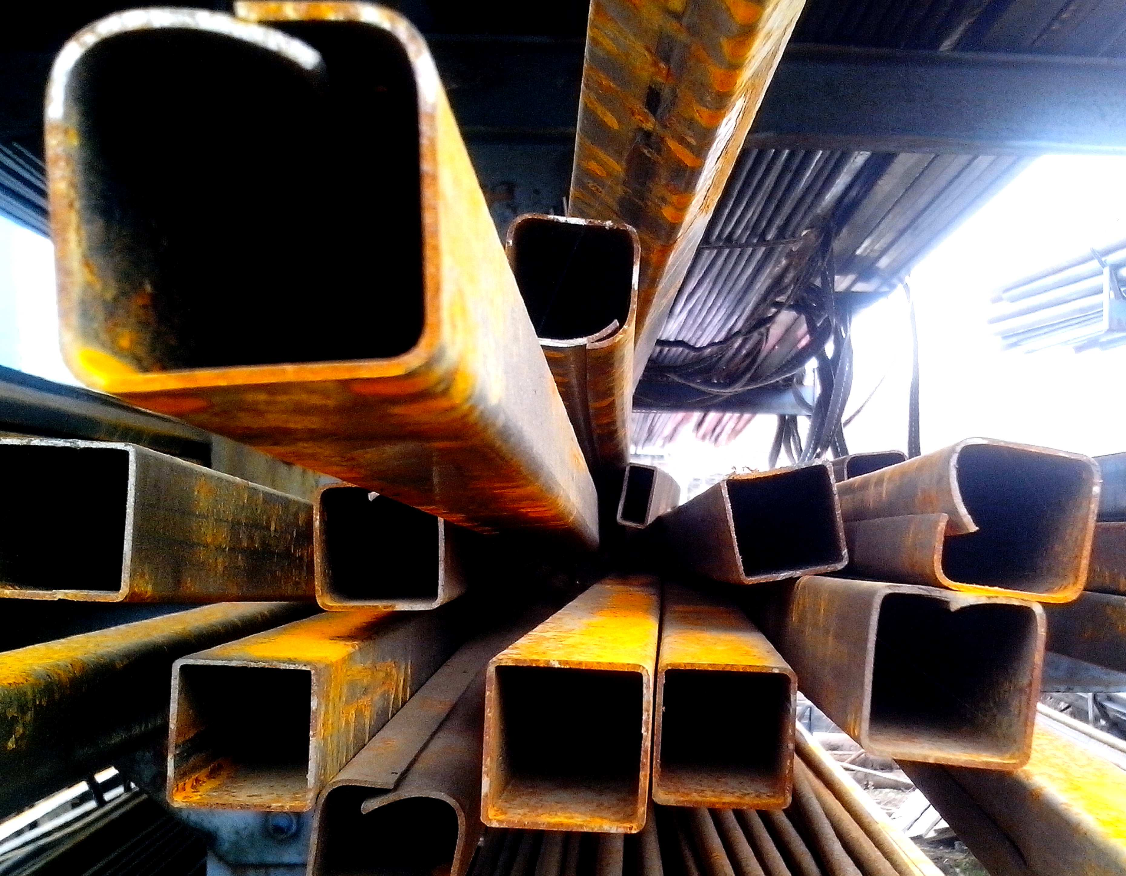 Free photograph; rusty, metal, pipes, stacked