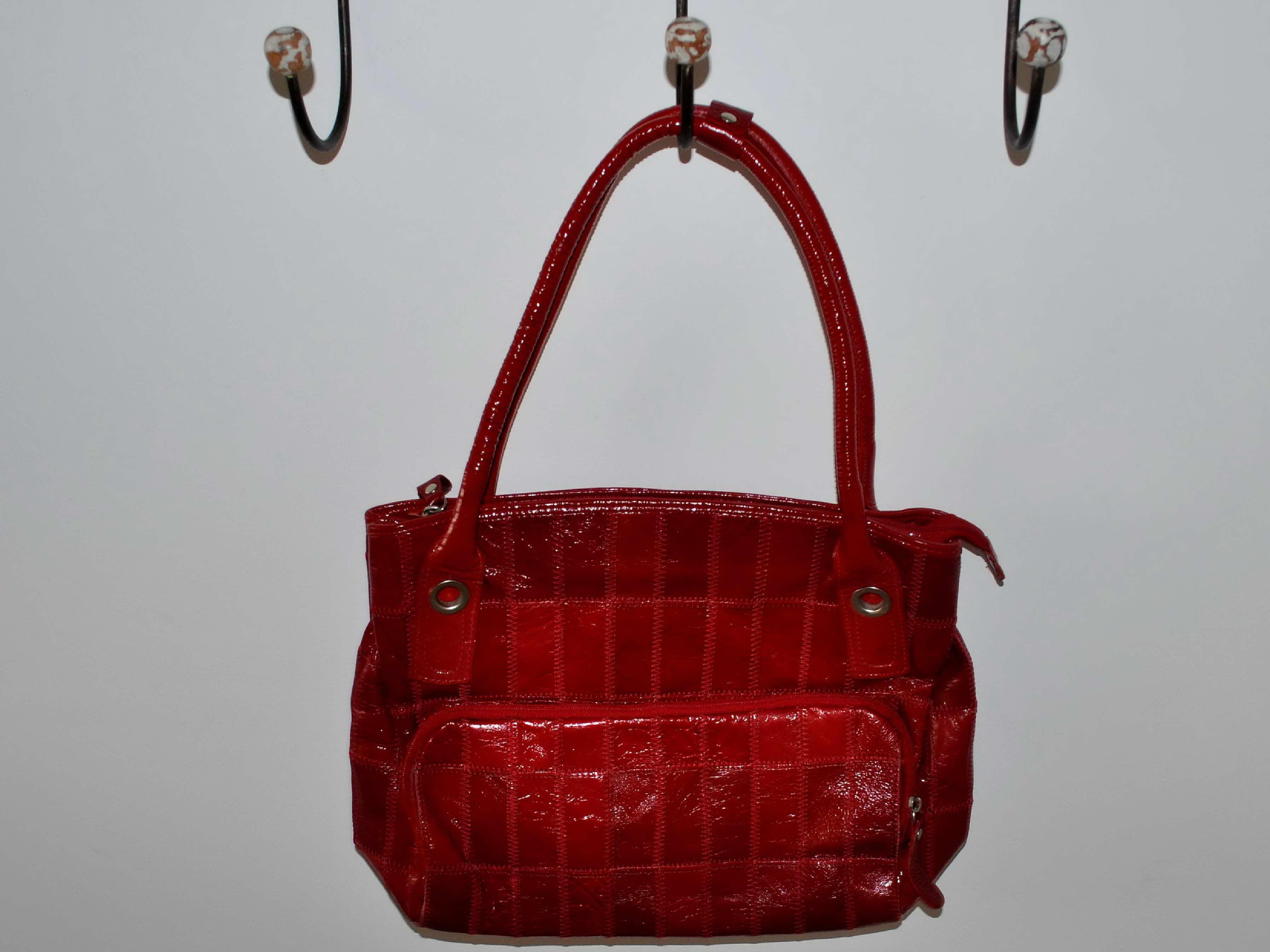 Free photograph; woman, red, handbag, hanging, hanger