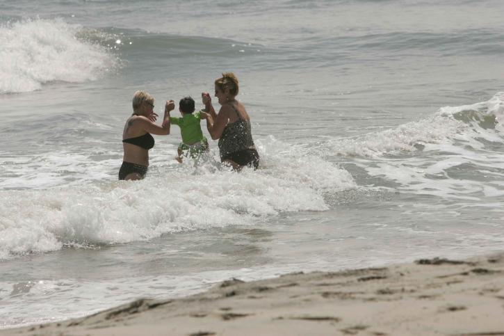 family enjoying, dip, ocean