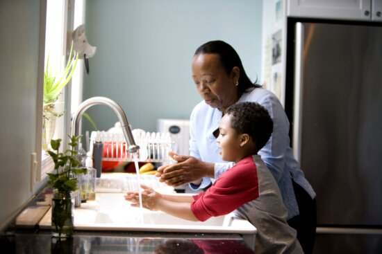 African American, mother, shown, process, teaching, young son, wash