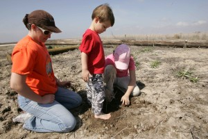 young boy, helps, sister, mother, girl, scouts, plant, trees