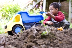 African American, cute, young boy, play, toys, backyard, dirt, pile