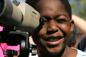 Afro American boy, face, child enjoying, lens, binocular