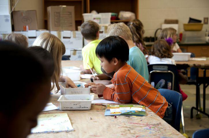 Asian, American, school boy, process, creating, drawing, choosing, box, crayons