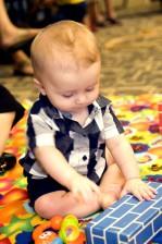 baby, cross, legged, position, carpeted, floor