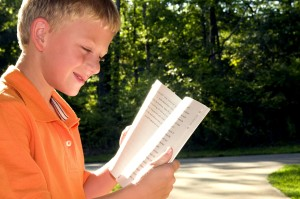 boy, photographed, reading, book, outdoors, setting