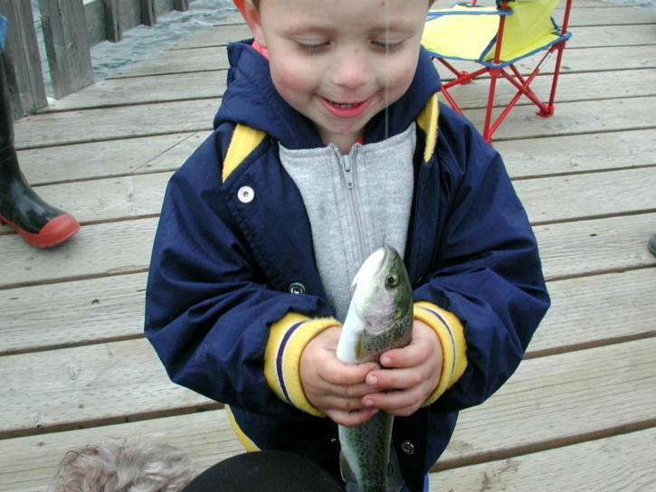 child, holding, fish, pier